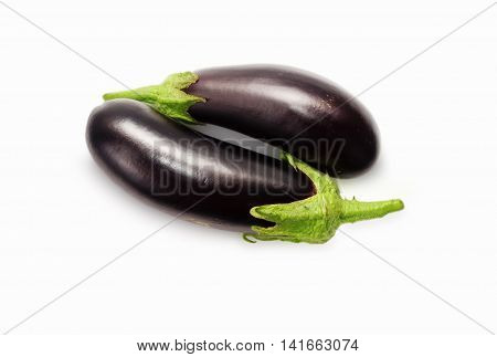 Fresh eggplant or aubergine over white background. Top view.