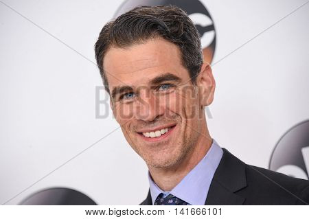 LOS ANGELES - AUG 04:  Eddie Cahill arrives to the ABC TCA Press Party 2016 on August 04, 2016 in Hollywood, CA