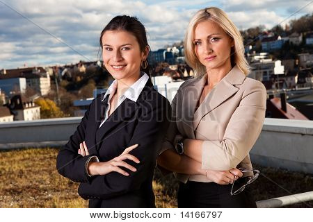 Two confident businesswomen ouside