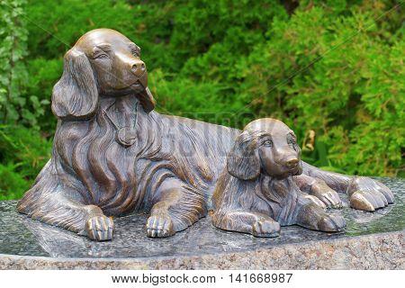 KIEV UKRAINE - 18 JUNE 2016: The two dogs: mother and her cub. Recently erected statue in Kiev Ukraine