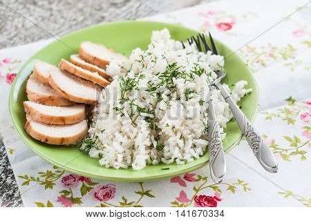 White Rice With Greens And Sliced Pieces Of Meat Grilled On A Green Plate