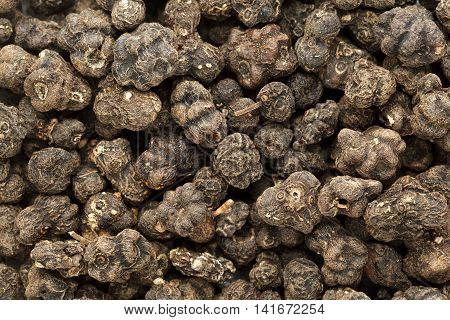 Organic Dried Cheese Fruit or Noni (Morinda citrifolia) seeds. Macro closeup background texture. Top View.
