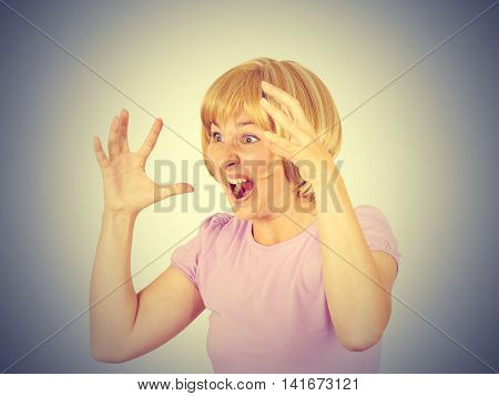 Young Woman Screams In Terror, Faces Portrait.