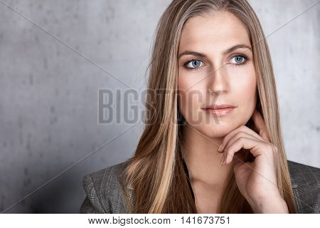 Closeup portrait of beautiful young woman looking away.