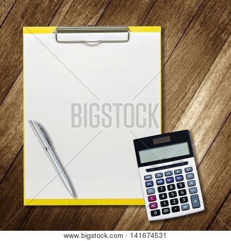 stationery office equipment and notepaper on wooden background