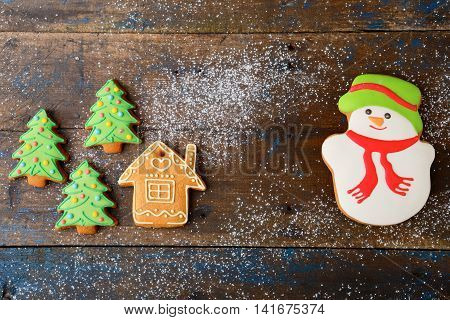 Christmas Cookies In The Shape Of Snowman, House And New Year Tree