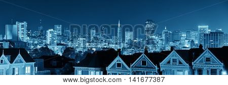 San Francisco city skyline with urban architectures at night from Alamo Square.