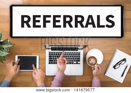 REFERRALS Business team hands at work man business  businessman vision work