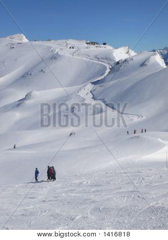 Skiers And Long Ski Run