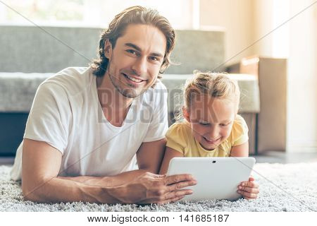 Father And Daughter With Gadget