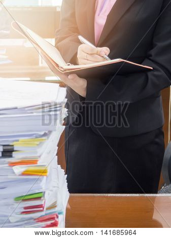 Businesswoman discussing ideas after meeting in office