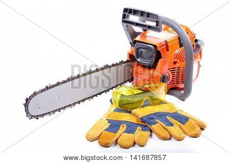 Chain saw, goggles and gloves on a white background.