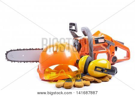 Chain saw, hard hat, earmuffs, goggles and gloves on a white background