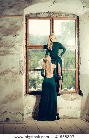 Pretty Women In Green Dresses Near Window