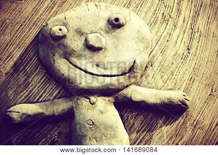 smiling happy child sculpture, happy boy character