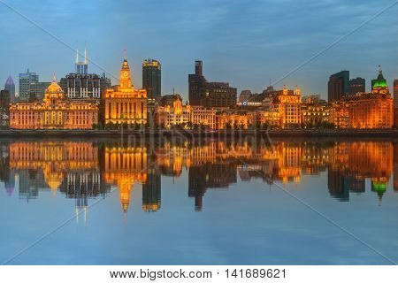 Skyline of The Bund, marvellous historical buildings and Huangpu River on sunset, Shanghai, China.