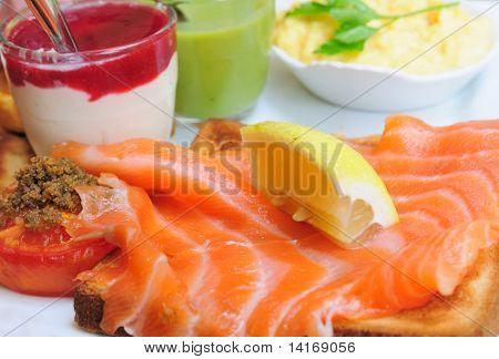 Fresh Salmon with lemon and bread - A seafood salad with smoked salmon