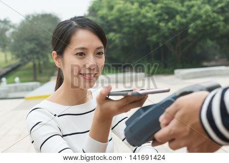 Woman pay on pos machine