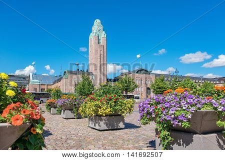 View of Railway (Rautatientori) square and Central station with clock tower. Helsinki Finland