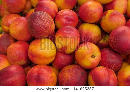 Group of healthy peaches for sale on a market