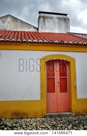 Wooden door in the facade of a typical Portuguese rural house of Alentejo region