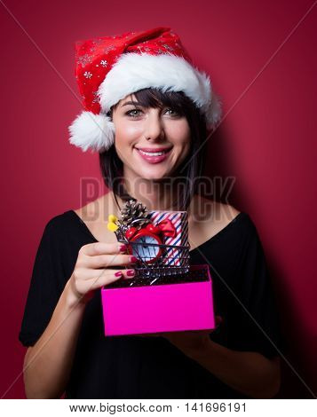 Young Woman With Shopping Cart And Gifts