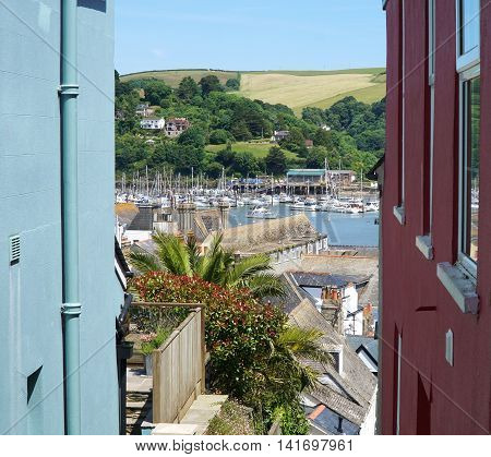 Dartmouth, Devon, View Of Fields And Houses Between Colourful Buildings
