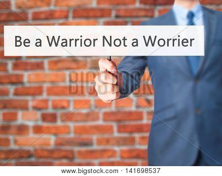 Be A Warrior Not A Worrier - Business Man Showing Sign