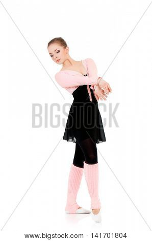 Young beautiful dancer posing on isolated white studio background. Pretty woman - modern style dancer or ballerina in ballet pose.