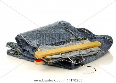 pair of jeans with a clothes hanger