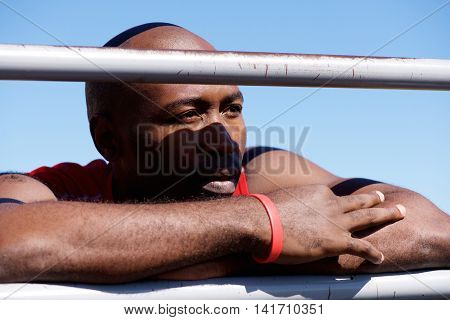 Fit Young Black Man Leaning On Railing Outdoors