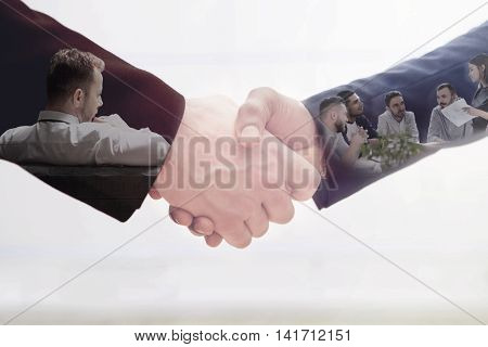 Handshake of two business man on white. Double exposure concept of business team work.