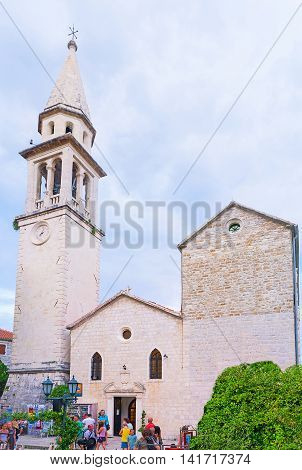 BUDVA MONTENEGRO - JULY 15 2014: The facade of the medieval St Ivan's Cathedral with the slender bell tower located in the old town - citadel on July 15 in Budva.