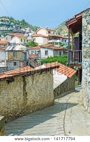The narrow winding street of the hilly Pelendri village located in Troodos District Cyprus.