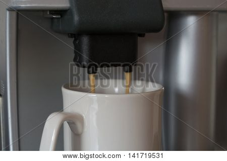 well-deserved coffee is prepared with coffee machine