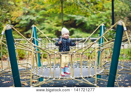 Girl Jumping On A Trampoline In The Autumn Park