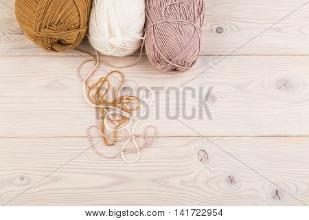 Three Bundles Lie On Wooden Table