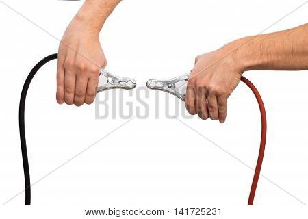 Hands of mechanic holding car jumper cables