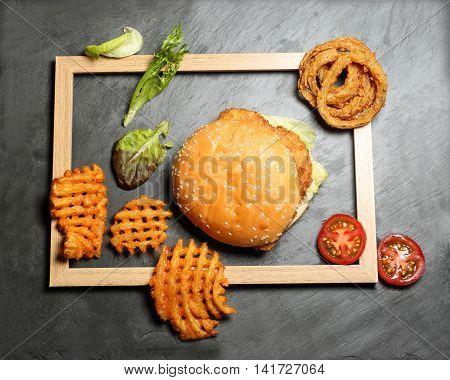Hamburger Cheeseburger burger waffle potato fries tomato onion ring tomato lettuce