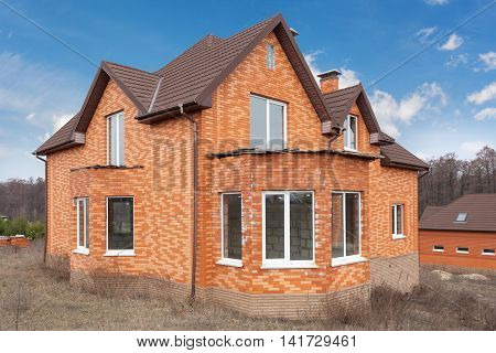 Beautiful new brick hoouse with plastic windows and metal tiler roof
