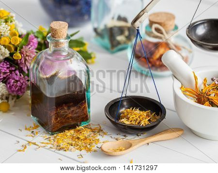Bottles Of Tincture And Healthy Herbs, Mortar On Table. Herbal Medicine. Selective Focus.
