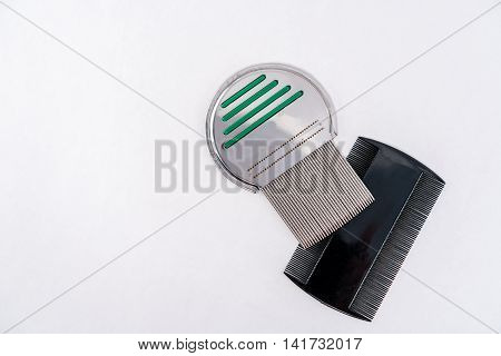 Lice treatment louse comb, two different types. Plastic and steel.