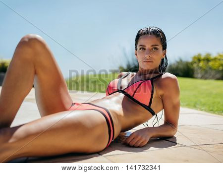 Beautiful Young Woman Lying By The Swimming Pool