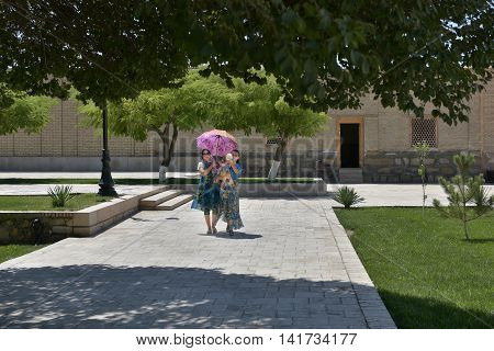 Bukhara, Uzbekistan - August 05, 2015: Local residents on the streets of the old town of Bukhara.