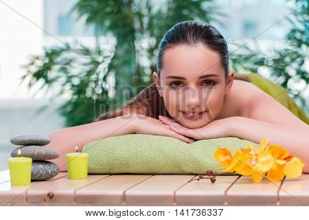 Young beautiful woman during spa procedure