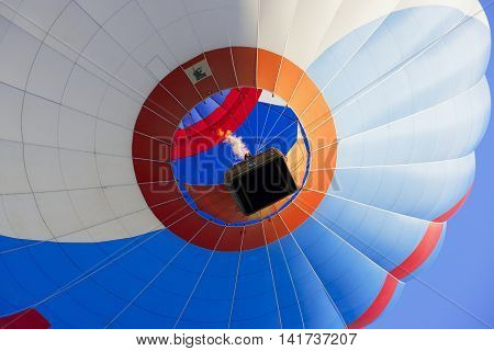 VILNIUS, LITHUANIA - AUGUST 23, 2015: View to the hot air balloon flying over the old town in Vilnius, Lithuania.