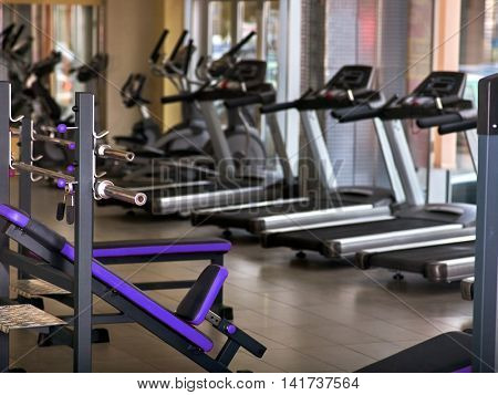 Group of jogging treadmill at sport gym. Group of treadmill in row big sport gym.