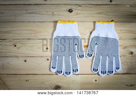 Gloves on wooden background in vintage taken in top view