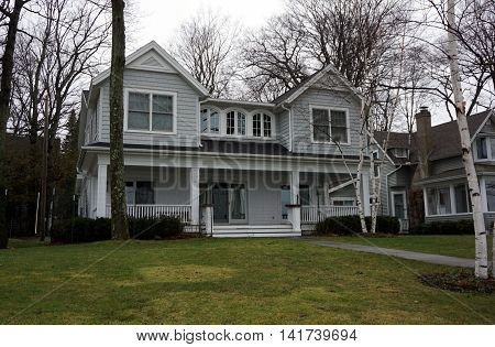 WEQUETONSING, MICHIGAN / UNITED STATES - DECEMBER 22, 2015: A home on Beach Drive in Wequetonsing, Michigan.