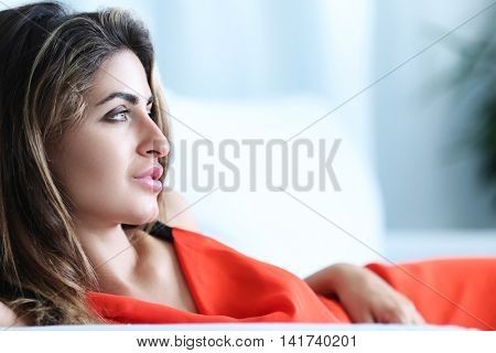 Lifestyle. Lovely woman in red dress